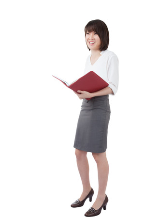 to ponder: Business woman attractive young pretty in office standing enjoy reading diary note book ponder positive on white background