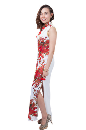 qipao: Chinese woman in cheongsam of traditional Chinese dress, full length portrait isolated on white background.
