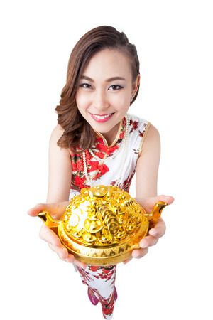 gold facial: Happy chinese new year. Woman pointing show gold at camera above in high angle view. Wide angle, almost fish eye effect. Smiling mixed chinese asian  caucasian woman. Isolated on white background.