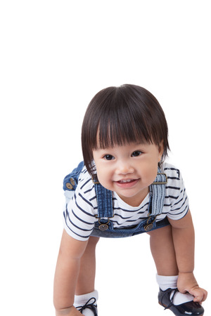 cheesy grin: Beautiful baby, black hairs, isolated on white,