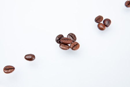 sort out: Heap of coffee beans and count coffee beans. isolated on white background.