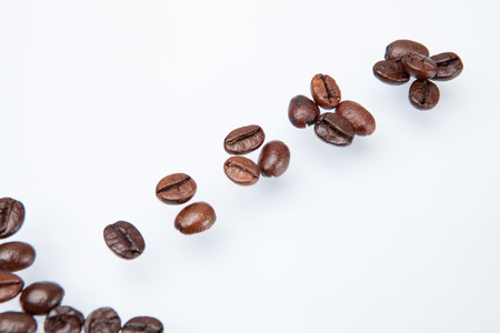 processed grains: Heap of coffee beans and count coffee beans. isolated on white background.