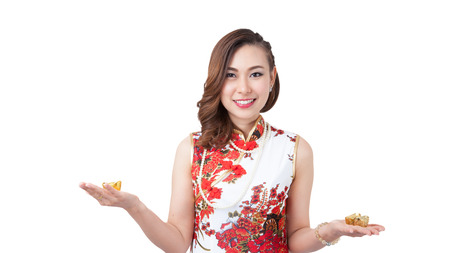 red envelope: Happy chinese new year. smiling beauty Asian woman showing gold and red envelope for lucky. get rich and happy  Isolated on white background. Stock Photo