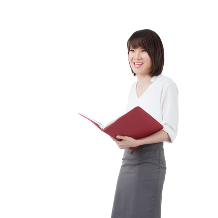 ponder: Business woman attractive young pretty in office standing enjoy reading diary note book ponder positive on white background