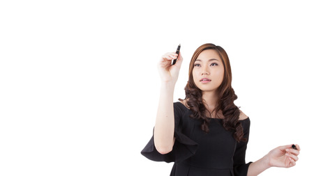 'one woman only': Business success growth chart. Businesswoman drawing graph showing profit growth on virtual screen. Asian businesswoman isolated on white background in suit. Stock Photo