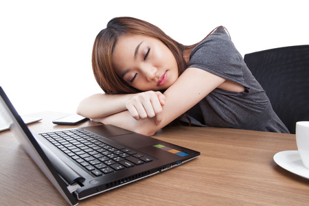 power nap: Business woman sleeping on laptop taking a power nap during work Isolated
