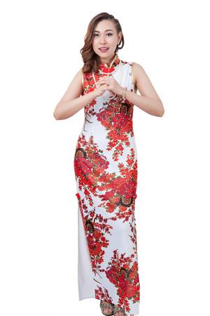 Ragazza orientale augurandovi un felice anno nuovo cinese. / Giovane bellezza ragazza cinese. Isolato su sfondo bianco. Archivio Fotografico - 62172213