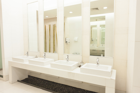 Commercial bathroom. on white color room. Empty advertisement frames in public toilet