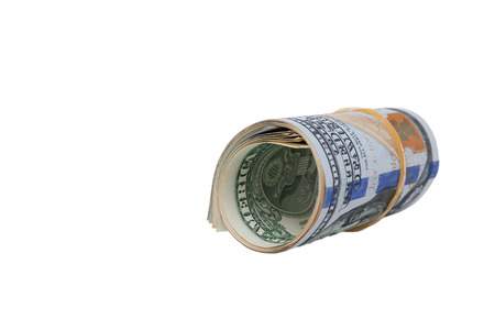 path to wealth: Rolled $100 dollar bills and isolated on white background and have clipping path.
