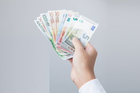 path to wealth: Money in the hand (Hand with money, Hand holding Banknotes), have clipping path.