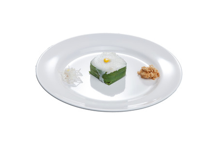 fareast: Thai Candy TACO preparation on white bowl with coconut and dried shredded pork, have clipping path. Stock Photo