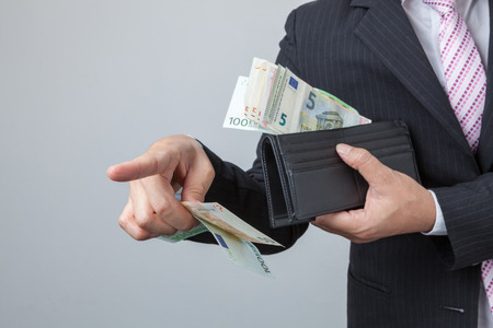 overdraft: Businessman purse with Euro in their hands. Holding bangnotes out wallet.