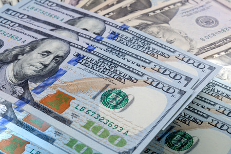 pile of money: Pattern of one hundred dollar bills pile.  money background. Stock Photo
