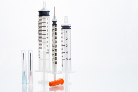 orenge: Syringe cap on an isolated white background Stock Photo