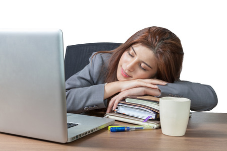 power nap: Business woman sleeping on laptop taking a power nap during work Isolated, have clipping path.