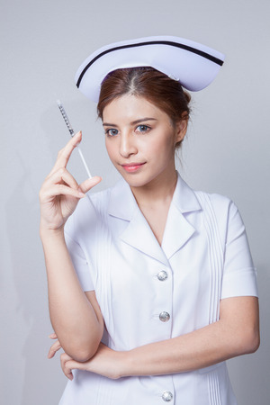 Young woman asian nurse attractive beauty brunette in white background Stock Photo
