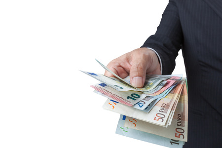 path to wealth: Business Man Displaying a Spread of Cash over isolated a white background. have clipping path Stock Photo
