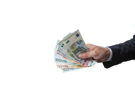 path to wealth: Business Man Displaying a Spread of Cash over isolated a white background, have clipping path. Stock Photo