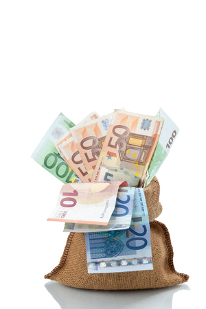 path to wealth: Bag of money with different euro bills isolated in studio shot on white background. have clipping path.