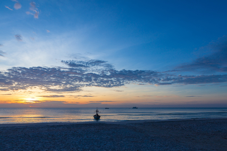 An impressive sunrise over the sea at Hua Hin beach, Thailand.