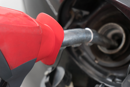 fueling pump: Refilling the car with fuel on a filling station.