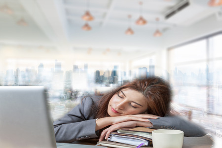 power nap: Double exposure business woman sleeping on laptop taking a power nap during work and Bangkok city view background as a concept. Stock Photo