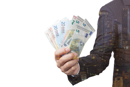 Business Man Displaying a Spread of Cash over isolated a white background