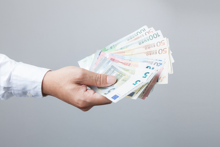 Money in the hand (Hand with money, Hand holding Banknotes), have clipping path.