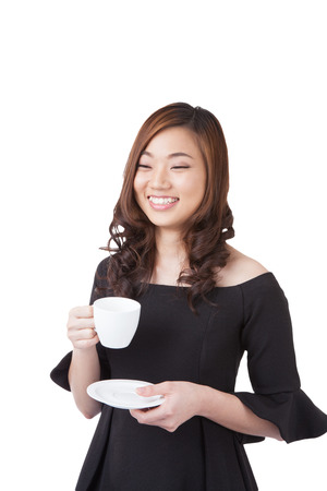 Happy smiling young businesswoman with coffee break from cup. Beautiful mixed asian / caucasian model. Isolated white background. / standing holding coffee cup have clipping paths