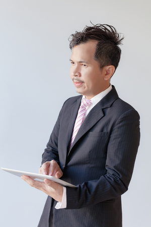 Portrait young businessmen using touchpad / Focus touchscreen to tablet for present