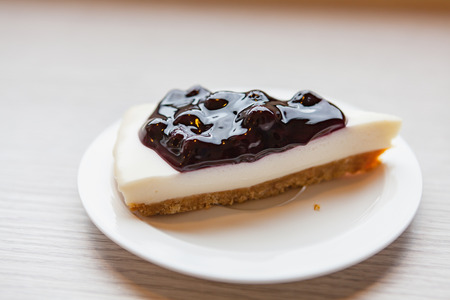 A piece of blueberry chess pie on the wooden table Stock Photo