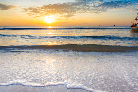 Bright sunrise over the beach an impressive at Hua Hin beach, Thailand. Stock Photo