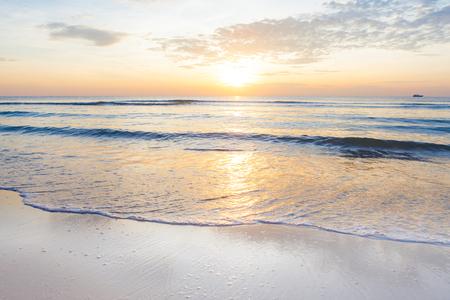 Bright sunrise over the beach an impressive at Hua Hin beach, Thailand. Stock Photo