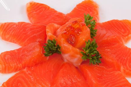 Japanese food salmon sashimi slices on a white plate, isolated white background.