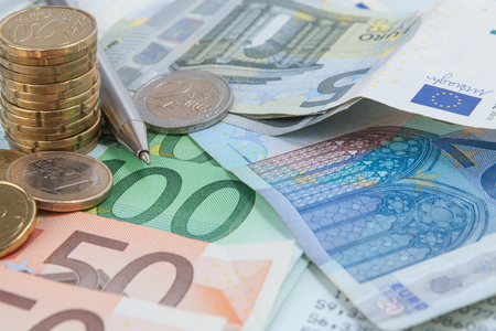 Finance background with money, cion and bill or banknotes. Stock Photo