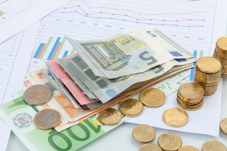 Financial and business chart and graphs, Euro money coin and banknotes