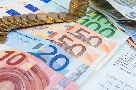 statement of account with the money on top  reviews the accounting benefits across many euro banknotes Stock Photo