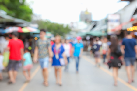 Abstract blur tourist shopping in Chatuchak weekend market outdoor in sunny day Bangkok Thailand background.