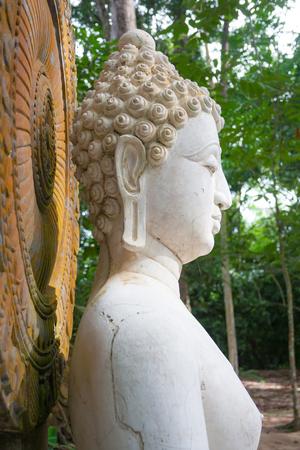 Buddha, face of budda statue in Suan Mokkh Buddhist temple Stock Photo