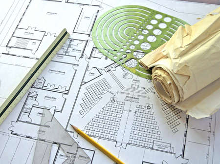 people in church: Drawing plans for church with architectural instruments