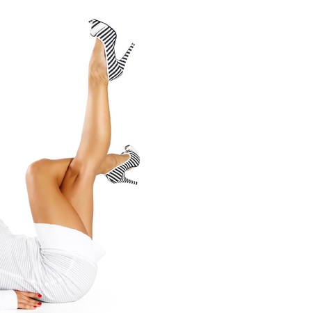 Legs and high heels on a white background