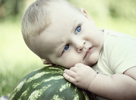 little baby with watermelon outdoors Stock Photo - 11576202