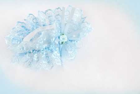 Wedding background with  blue bridal garter on the down Stock Photo