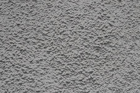 Gray bumpy concrete wall texture as a background Stock Photo