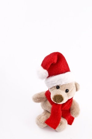 teddy bear in Santa hat on white background Stock Photo