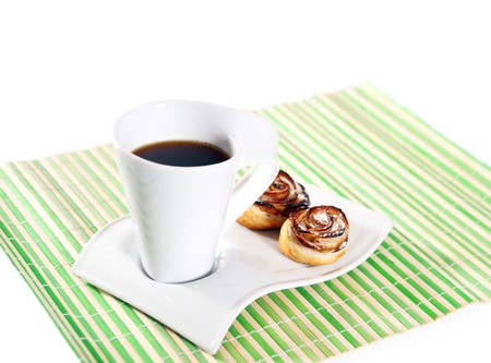 cup of hot coffee and cakes for breakfast