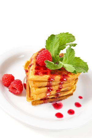 breakfast   waffles with raspberries, mint and jam on plate