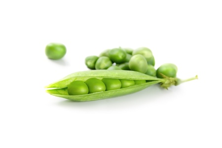 Fresh green peas vegetable closeup isolated on white