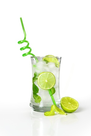Refreshing cold mojito drink with fresh lime slices and ice Stock Photo