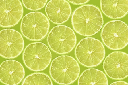 Abstract green background with citrus-fruit of lime slices. Close-up pattern